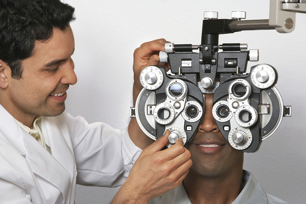 man receiving an eye exam from his optometrist
