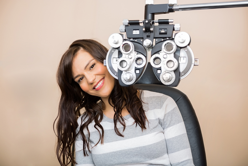 woman getting an eye exam from her eye doctor